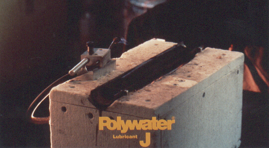 All of the wax, wax/soap, and polymer-type lubricants tested had residues significantly more combustible then fire-retardant cable jacket. Only one lubricant tested, Polywater&#174 J, showed little tendency to burn or spread fire. Polywater&#174 J was less combustible than the fire-retardant cable jacket control!.