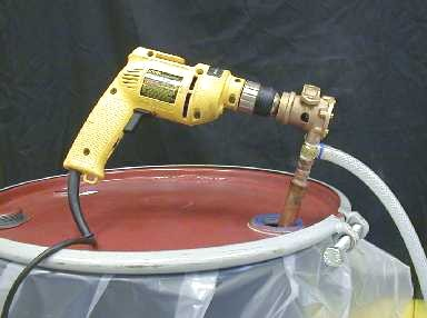 Pump Model LP-D5 for 5-gallon pails and 55-gallon drums (drill-operated).